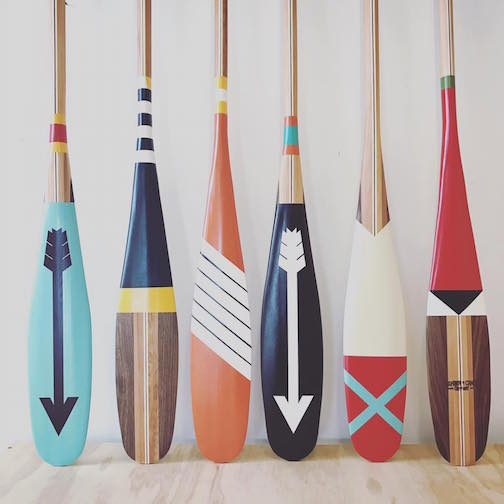 Colorful paddles made by Sanborn Canoe Co. are at Upstate MN.
