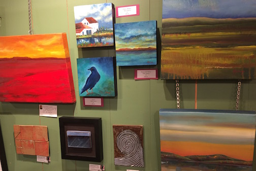 A wall of art, including work by painter Heidi Sobanja and tile maker Melissa Wickwire.