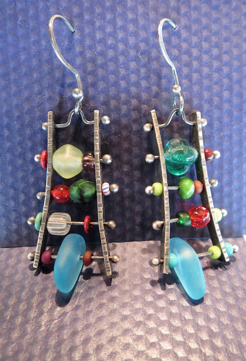 Last Chance Gallery has fun newly designed earrings by Kathy Dawdy in her Kitschigumi line. Sterling, beads and beach glass