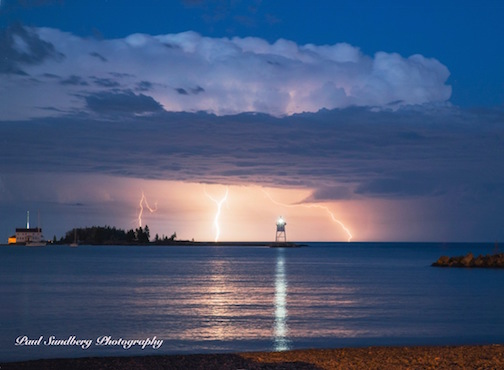 Lightning storm over Grand Marais Harbor by Paul Sundberg.