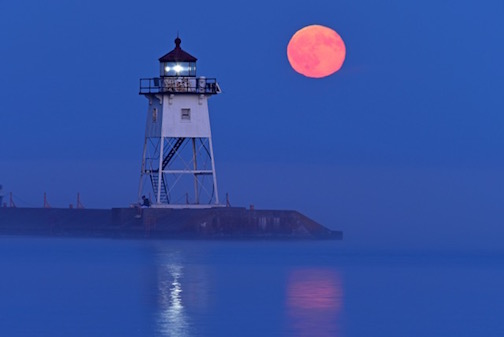 Full moon over the lighthouse by Kathy Gray-Anderson.