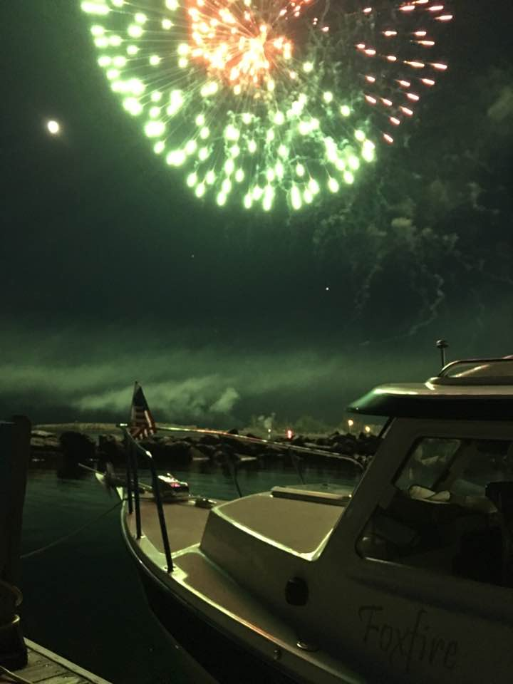 """""""The moon, the fireworks, the boat, and thee,"""" by Todd Miller."""
