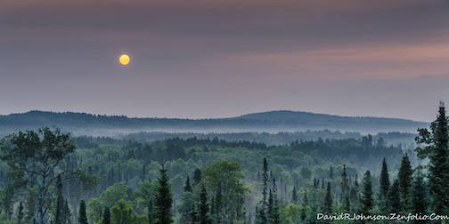 Smoke from fires in Canada gave this sunrise a cool hue by David Johnson.