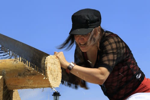 Autumn Pechan takes on the cross cut saw at Fisherman's Picnic in 2014. Photo by Judy Griesedieck.