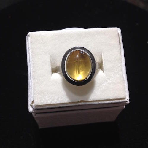 Ron's World Rocks is featuring this yellow topaz ring. The stone was mined in Brazil and sourced in India. It is mounted on sterling silver with a black patina.