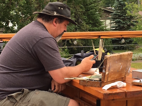 Plein air painter Neil Sherman sets to work during the Arrowhead Sketchers event last Thursday from the roof-top deck at Voyageurs Brewing Co.