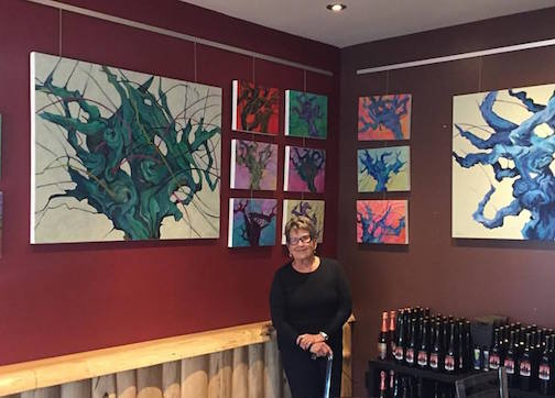 Hazel Belvo with her works at the North Shore Winery.