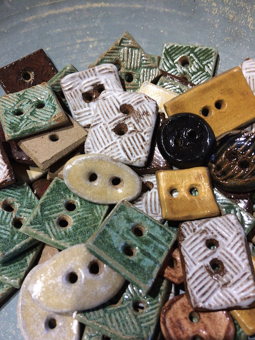 Melissa Wickwire has handmade buttons at the bookstore at North House Folk School.