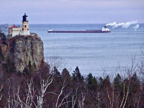 A ship passes Split Rock Lighthouse by MaryJane Van Den Heuvel.