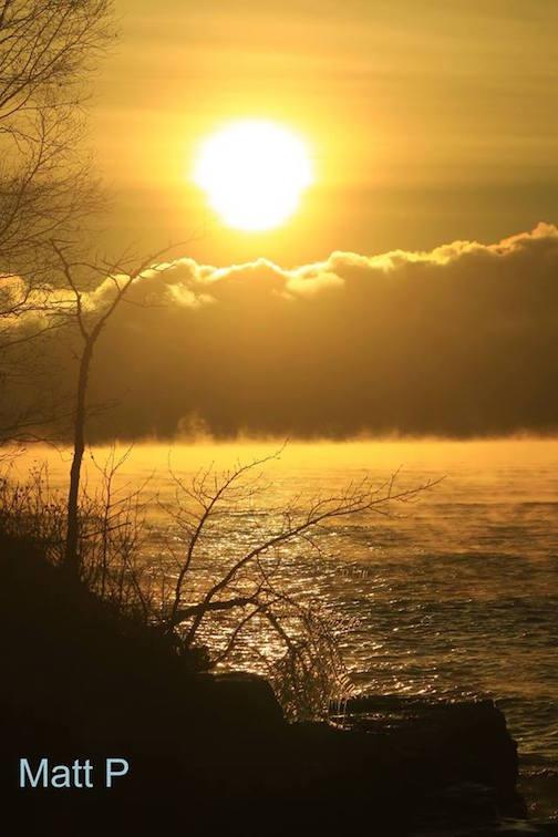 Sea fog at sunrise by Matthew Pastick.