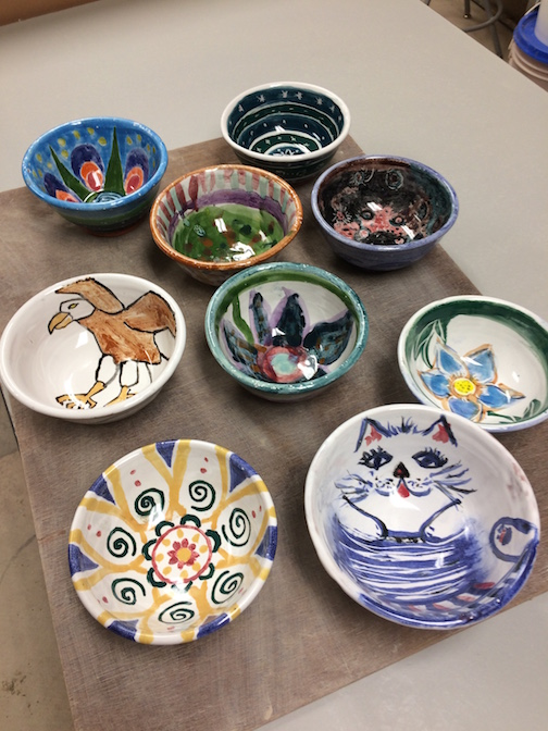 A few of the hand-painted bowls that will be at the Empty Bowls fundraiser this year. There will be a great selection of glazed bowls as well.