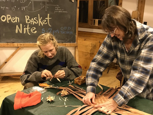 Julie Kean and her daughter Meadow Adams make baskets at Open Basket night at North House Folk School.