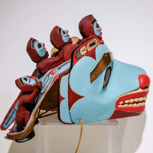 """Reg Williams, """"Tsimshian Sea Monster Carrying Souls of the Dead to the Undersea World,"""" 1989. Carved and painted wood, hide, copper"""