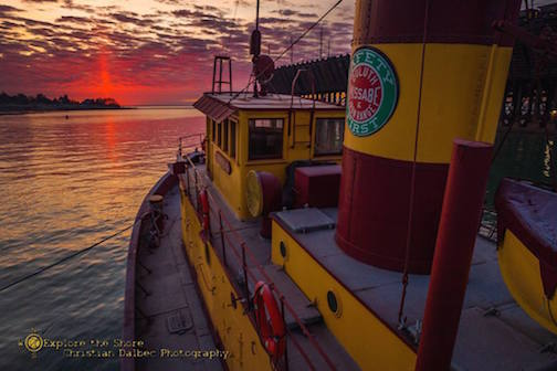 Edna G. tugboat headed out to sea by Christian Dalbec.