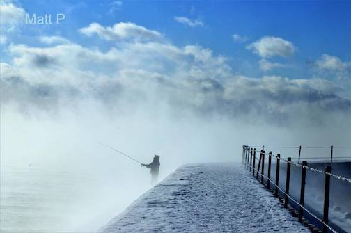Sea smoke and a fisherman by Matthew Pastick.
