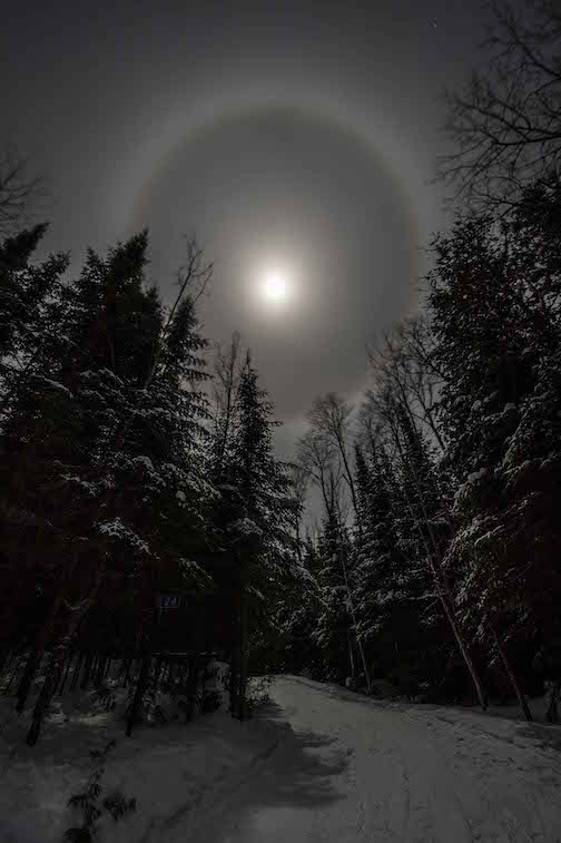 A frosty Supermoon with halo by Dennis Chick.
