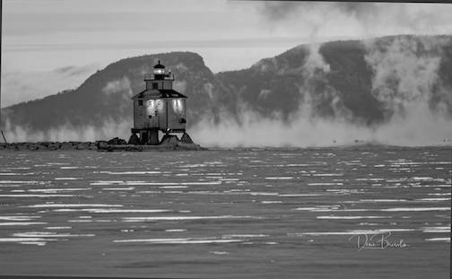 Lighthouse in front to the Sleeping Giant (in Thunder Bay) by Dennis Bresolin.