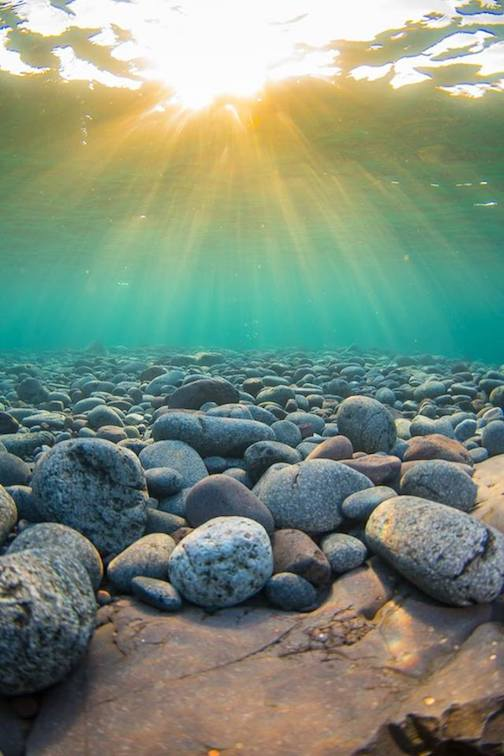 Underwater sunrise at Split Rock by Christian Dalbec.
