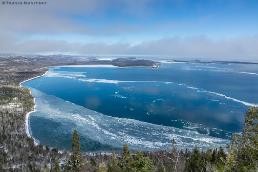 Winter ice on Wauswaugoning Bay by Travis Novitsky.