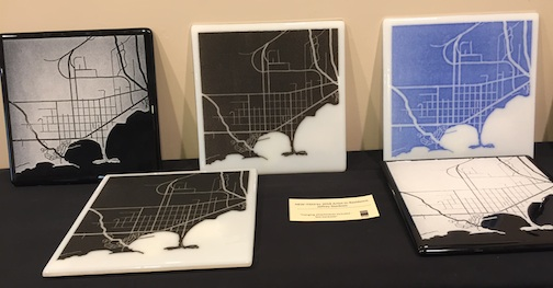 Glass artist Jeffrey Stenbom was an artist-in-residence at the Grand Marais Art Colony earlier this year and created these fused glass maps of the city. Several of them are in the Grand Marais Gallery Store.