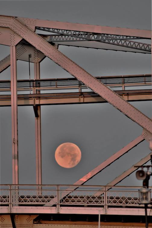 July full moon passing through the Aerial Lift Bridge in Duluth by Jan Swart.