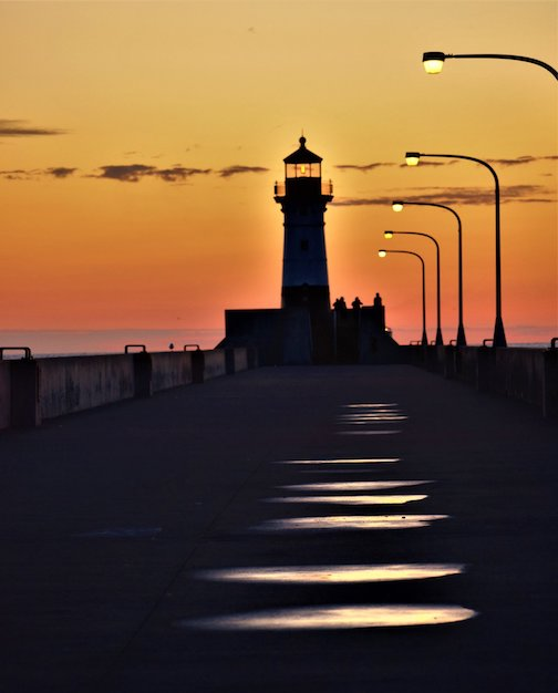 Sunrise. Puddles. The North Pier. Duluth by Jan Swar.