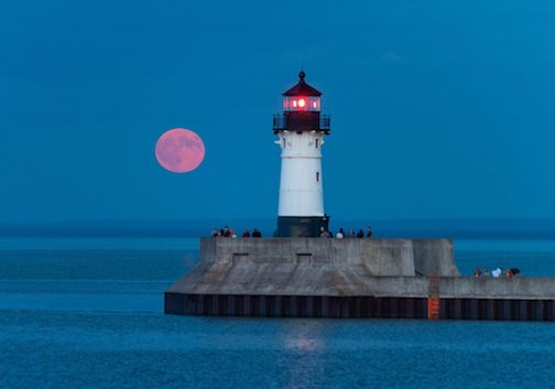 Red moon rising in Duluth by Ken Harmon.