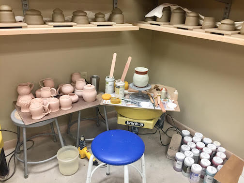 Getting ready for the Fall Studio Tour in the Grand Marais Art Colony's clay studio.