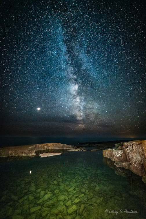 The Milky Way and Mars as seen over Grand Marais by Larry Paulson.