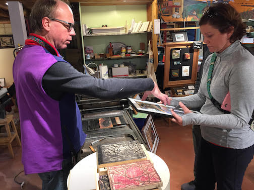 Jeremy Bowen explains how he printed Betsy Bowen's print, Tall Tree, to Kari Numinen of Burnsville during the Fall Studio Tour this week. Betsy is exhibiting her prints, books, cards and more at her studio.