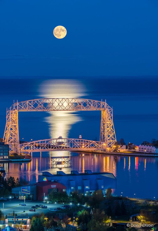 Near full Hunter's Moon over the Duluth harbor by Donald Jay Olson.