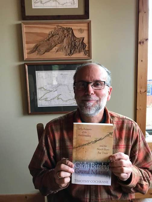 "Tim Cochrane holds a copy of his new book, ""Gichi Bitobig: Early Accounts of the Anishinaabeg and the North Shore Fur Trade."" It will be officially released Nov. 13."
