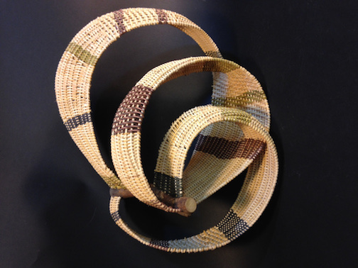 A sculptural weaving by  is on exhibit at the Johnson Heritage Post.