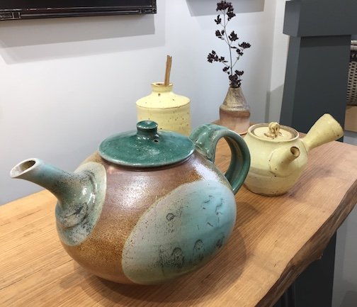 Tea pots by Tim Alexander (front) and Evan Hestegan are at Yellow Bird Fine Art Gallery through Dec. 23.