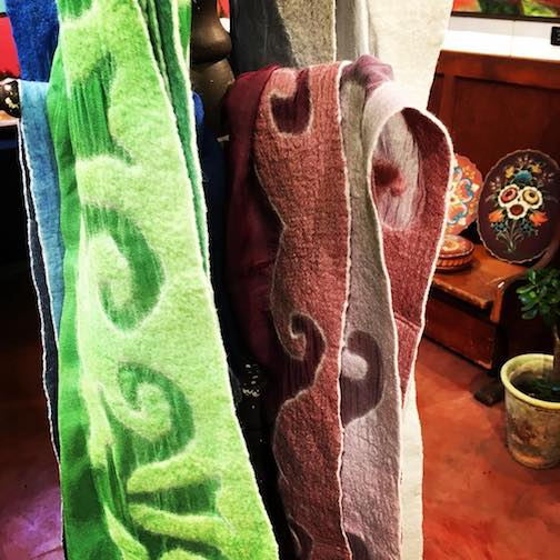 The Holiday Art Underground show continues at the Betsy Bowen Gallery and Studios featuring work by more than 20 local and regional artists. Mary Reichert made these silk and wool scarves.