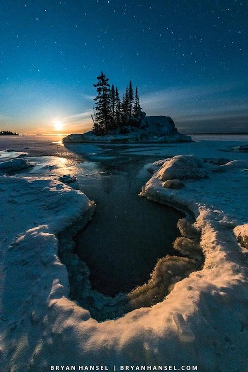 Rising moon, stars and a cool ice formation by Bryan Hansel.