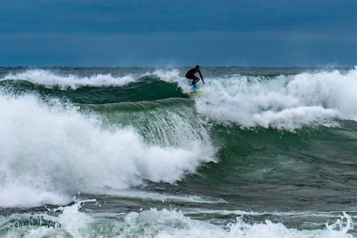 Jake Boyce surfing on the wild side by Kirk Schleife.