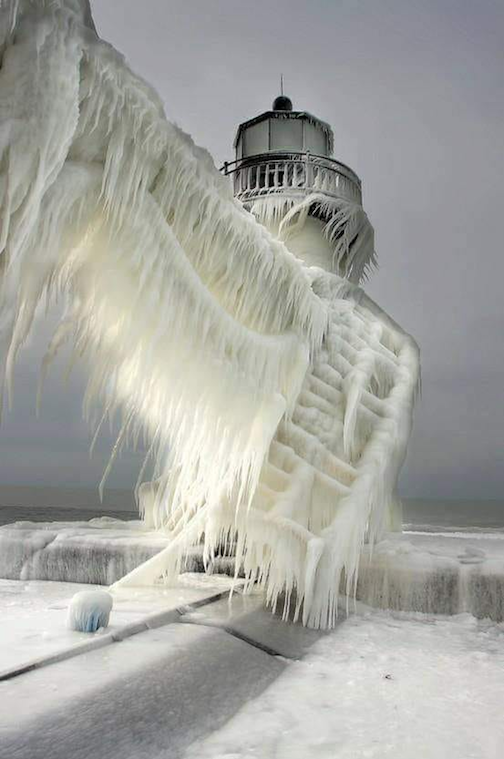 Frozen lighthouse, Lake Michigan by Thomas Zakowski.
