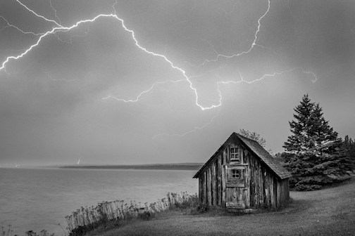 "'Lightning over Fishing Shack--Stoney Point"" by John Gregor, is one of the works in the Johnson Heritage Post exhibit."