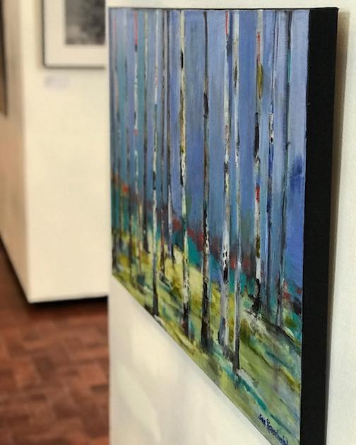 Sue Rauschendes painting, Birches on Parade, is one of the works on exhibit at the Members Show at the Duluth Art Institute.