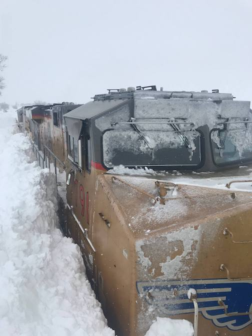 Train stuck in snow in Freeborn County has to be rescued by National Guard.