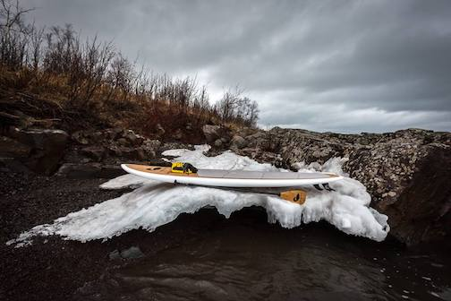 Paddle Board and Lake Superior ice by Christian Dalbec.