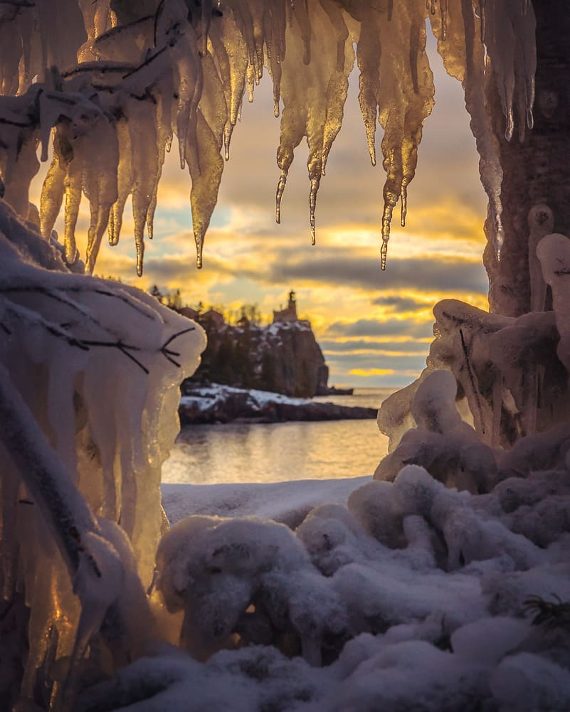 Gates of the Arrival: Sunrise through ice from the 3-day storm by Christian Dalbec.