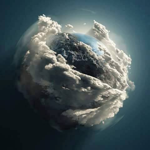 hubble telescope earth cradled by clouds