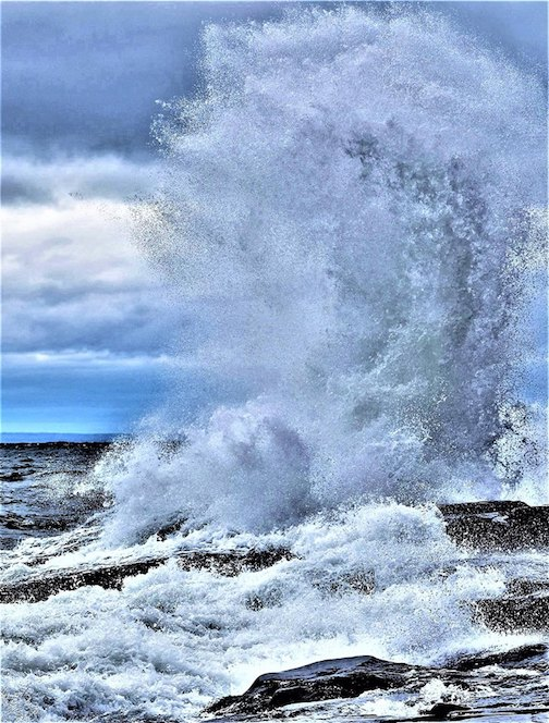 Jan Swart catches a Lake Superior wave hitting aa beach in Duluth on April 10.