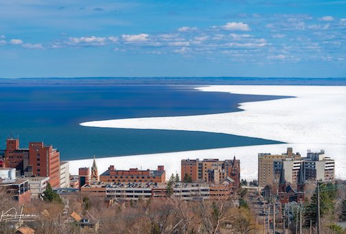 Half spring in Duluth--receding ice on Lake Superior by Ken Harmon.