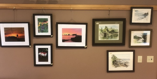 The Cross River Heritage Center opens for the season on Friday, and includes work by local artists. Pictured are watercolors by David Hahn and photographs by Kathy Gray Anderson.