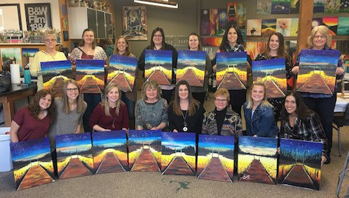 "Last year's ""graduates"" of the Painting Party at Gunflint Lodge."