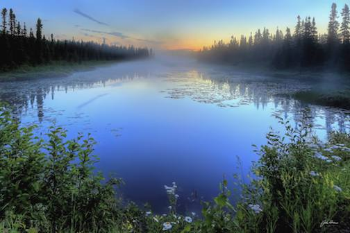 Misty fog at sunrise on the Gunflint Trail by John Heino.