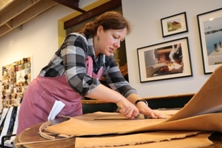 Leatherworker Beth Dow is the instructor in residence at North Houses Folk School this month.
